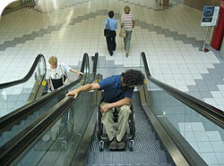 going up and an escalator the wheelchair zone